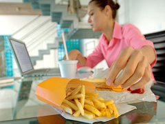 woman-eating-fries-at-work