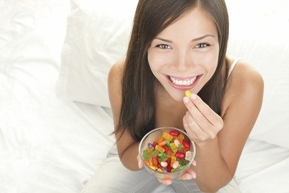 young-woman-eating-chewy-gummy-sweets